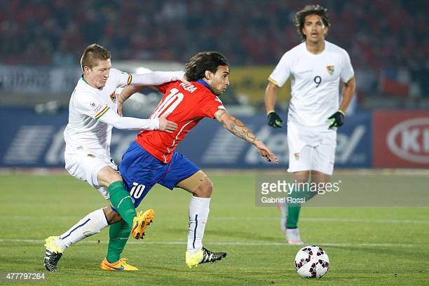 Jorge Valdivia of Chile fights for the ball with Alejandro Chumacero of Bolivia during the 2015 Copa America Chile Group A match between Chile and...