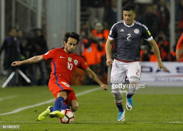 Jorge Valdivia of Chile fights for the ball with Jorge Moreira of Paraguay during a match between Chile and Paraguay as part of FIFA 2018 World Cup...