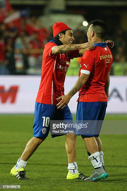 Jorge Valdivia of Chile fights for the ball with teammate Eduardo Vargas after winning the 2015 Copa America Chile Final match between Chile and...