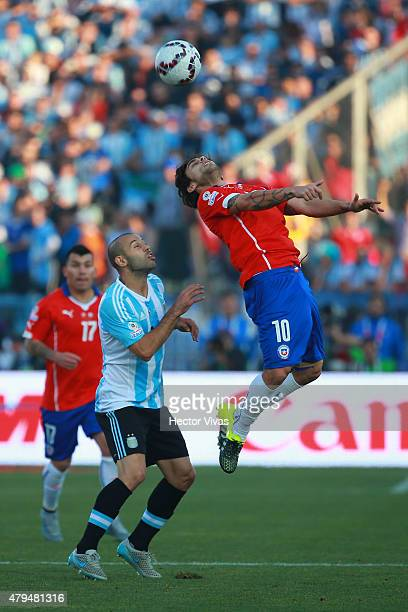 Jorge Valdivia of Chile goes for a header with Javier Mascherano of Argentina during the 2015 Copa America Chile Final match between Chile and...
