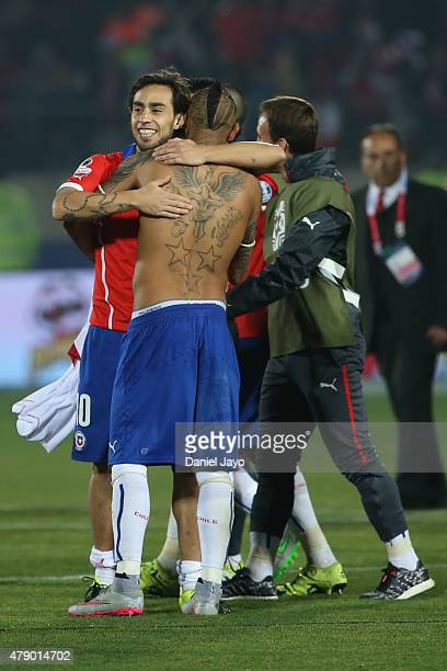 Jorge Valdivia of Chile hugs Arturo Vidal after the 2015 Copa America Chile Semi Final match between Chile and Peru at Nacional Stadium on June 29...