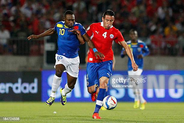Jorge Valdivia of Chile struggles for the ball with Walter Ayovi of Ecuador during a match between Chile and Ecuador as part of the 18th round of the...