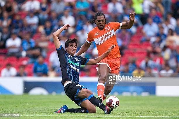 Jorge Valencia of Queretaro and Roberto Nurse of Correcaminos fight for the ball during match between Queretaro and Correcaminos as part of the...