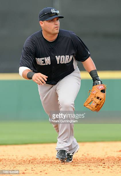 Jorge Vazquez of the New York Yankees fields against the Detroit Tigers during the spring training game at Joker Marchant Stadium on February 28 2011...