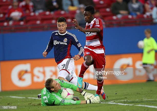 Jorge Villafana assist Tim Melia goal keeper of Chivas USA challenging a shot by Fabian Castillo of FC Dallas at FC Dallas Stadium on October 28 2012...