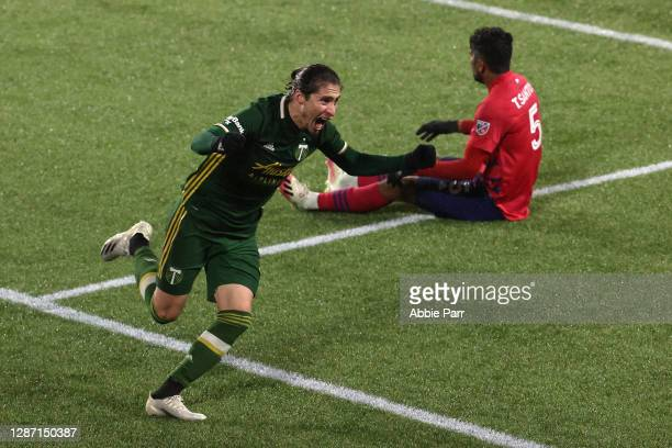Jorge Villafana of Portland Timbers celebrates after scoring a goal in the 82nd minute as Thiago Santos of FC Dallas reacts during Round One of the...