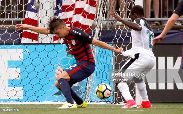 Jorge Villafana of the United States defends against Frank Acheampong of Ghana in the first half during an international friendly between USA and...