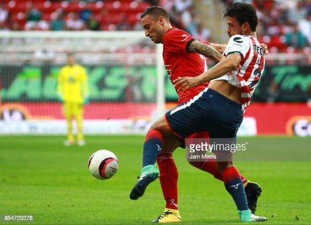 Jorge Villalpando of Lobos BUAP and Oswaldo Alanis of Chivas during the 11th round match between Chivas and Lobos BUAP as part of the Torneo Apertura...