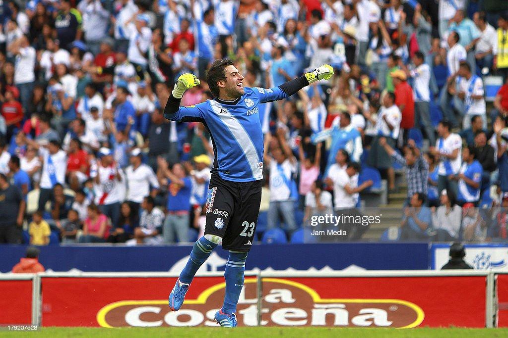 Jorge Villalpando of Puebla celebrates a goal against Atlante during a match between Puebla and Atlas as part of the Apertura 2013 Liga Bancomer MX at Cuahtemoc Stadium on september 01, 2013 in Puebla, Mexico.