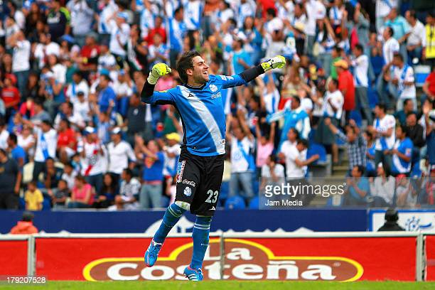 Jorge Villalpando of Puebla celebrates a goal against Atlante during a match between Puebla and Atlas as part of the Apertura 2013 Liga Bancomer MX...