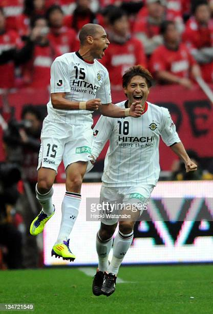 Jorge Wagner of Kashiwa Reysol celebrates the first goal with his teammate Junya Tanaka during the J.League match between Urawa Red Diamonds and...