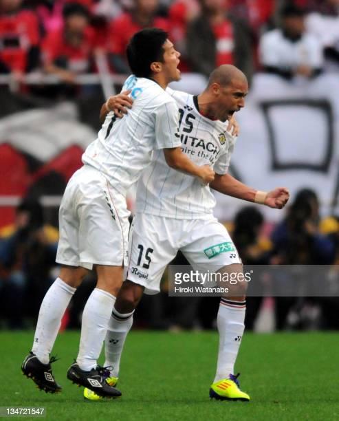 Jorge Wagner of Kashiwa Reysol celebrates the first goal with teammate Hidekazu Otani during the J.League match between Urawa Red Diamonds and...