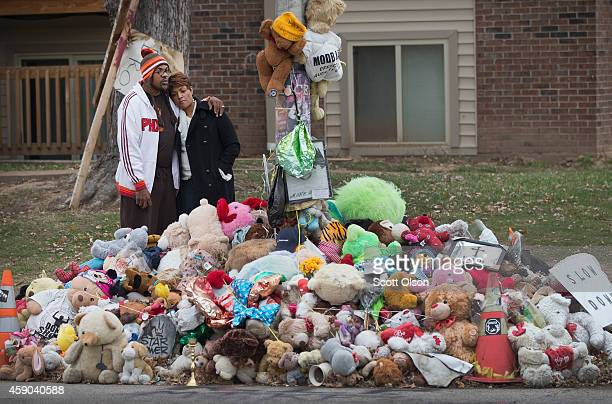Jorge Wallace and Krystal OFodile look over a roadside memorial near the location where 18yearold Michael Brown was shot on November 15 2014 in...
