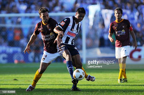 Jorge Zamogilni of Estudiantes fights for the ball with Sergio Santana of Monterrey during a match as part of the 2010 Apertura at Tecnologico...
