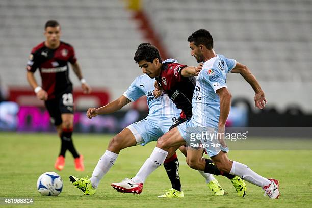 Jorge Zarate of Atlas fights for the ball with Antonio Nelson of Queretaro during a 1st round match between Atlas and Queretaro as part of the...