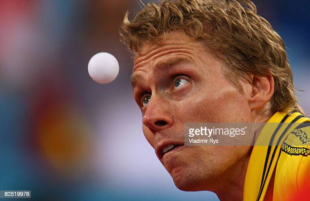 Jorgen Persson of Sweden serves to Wang Hao of China during the men's singles semifinal table tennis event held at the Peking University Gymnasium on...