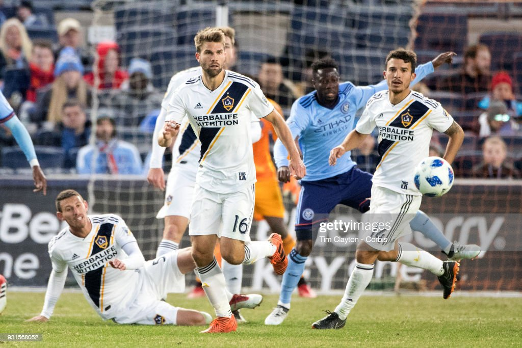 Jorgen Skjelvik #16 of Los Angeles Galaxy and Servando Carrasco #14 of Los Angeles Galaxy in action during the New York City FC Vs LA Galaxy regular season MLS game at Yankee Stadium on March 11, 2018 in New York City.