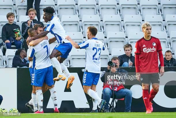 Jorgen Skjelvik, Viktor Fischer and Emmanuel Sabbi of OB Odense celebrate after scoring their third goal during the Danish 3F Superliga match between...