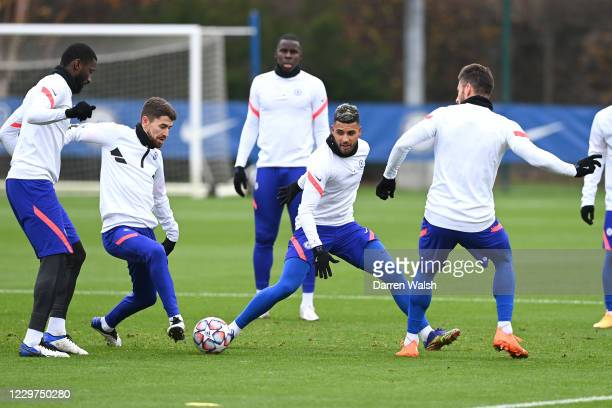 Jorginho and Emerson of Chelsea during a training session ahead of the UEFA Champions League Group E stage match between Chelsea FC and FC Sevilla at...