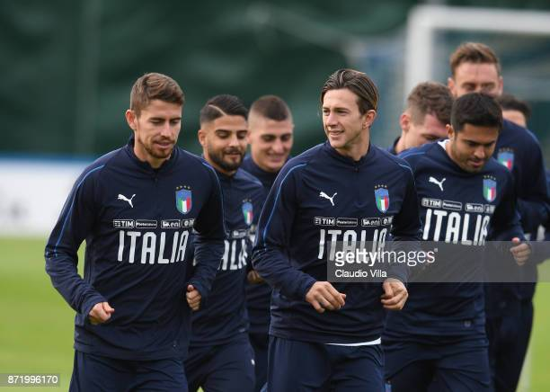 Jorginho and Federico Bernardeschi of Italy chat during the training session at Italy club's training ground at Coverciano on November 9 2017 in...