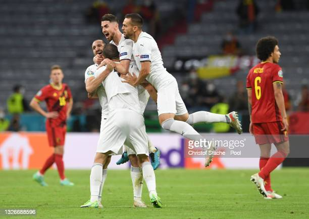 Jorginho and Giorgio Chiellini of Italy celebrate with teammates after victory in the UEFA Euro 2020 Championship Quarter-final match between Belgium...