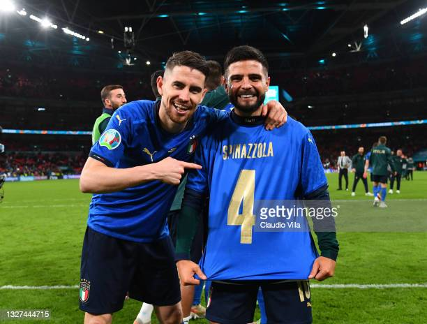 Jorginho and Lorenzo Insigne of Italy celebrate following their team's victory in the penalty shoot out after the UEFA Euro 2020 Championship...