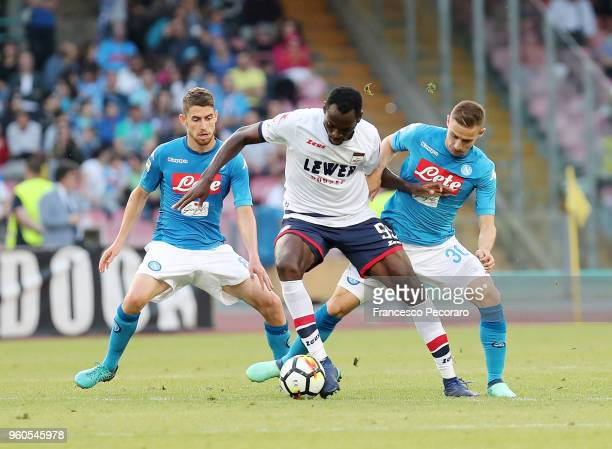 Jorginho and Marko Rog of SSC Napoli vie with Simy of FC Crotone during the Serie A match between SSC Napoli and FC Crotone at Stadio San Paolo on...