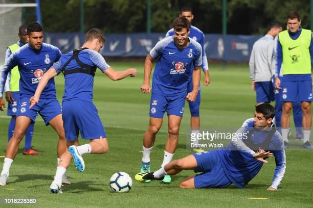 Jorginho Cesar Azpilicueta and Alvaro Morata of Chelsea during a training session at Chelsea Training Ground on August 17 2018 in Cobham England