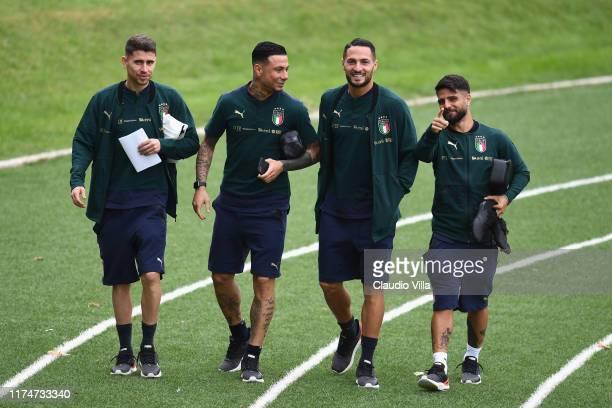 Jorginho, Danilo D'Ambrosio, Lorenzo Insigne and Armando Izzo of Italy chat during a Italy training session at Centro Tecnico Federale di Coverciano...