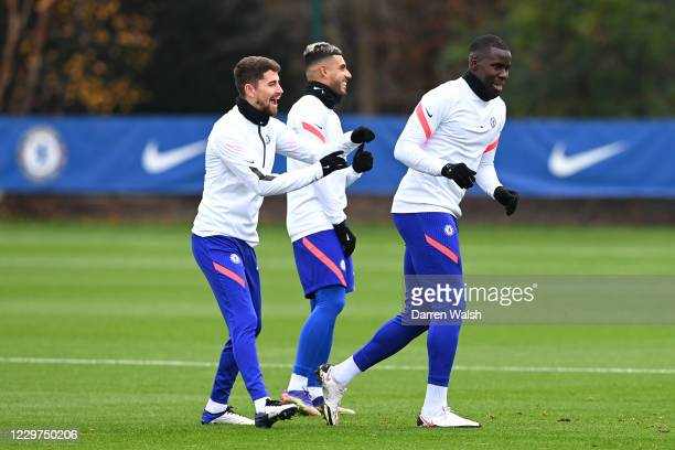 Jorginho, Emerson and Kurt Zouma of Chelsea during a training session ahead of the UEFA Champions League Group E stage match between Chelsea FC and...