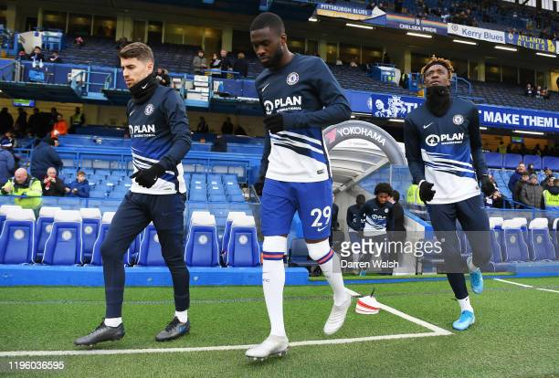 Jorginho Fikayo Tomori and Tammy Abraham of Chelsea make their way out onto the pitch prior to the Premier League match between Chelsea FC and...