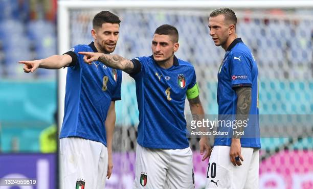 Jorginho, Marco Verratti and Federico Bernardeschi of Italy look on during the UEFA Euro 2020 Championship Group A match between Italy and Wales at...