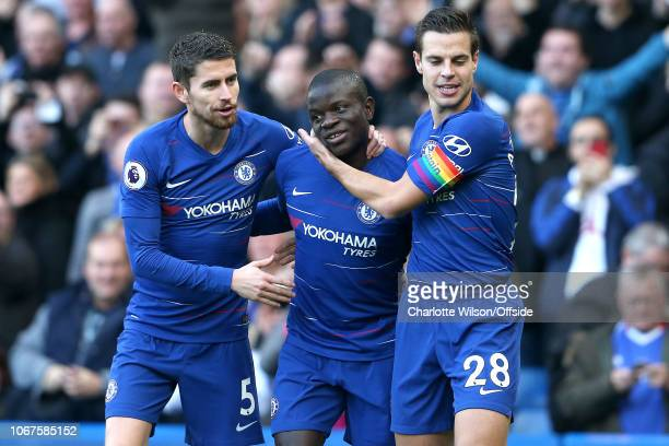 Jorginho of Chelsea and Cesar Azpilicueta of Chelsea celebrate their goal with Ngolo Kante of Chelsea who provided the assist during the Premier...