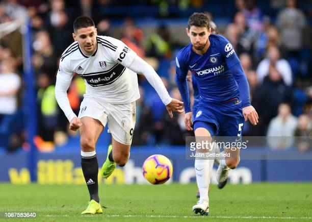 Jorginho of Chelsea battles for possession with Aleksandar Mitrovic of Fulham during the Premier League match between Chelsea FC and Fulham FC at...