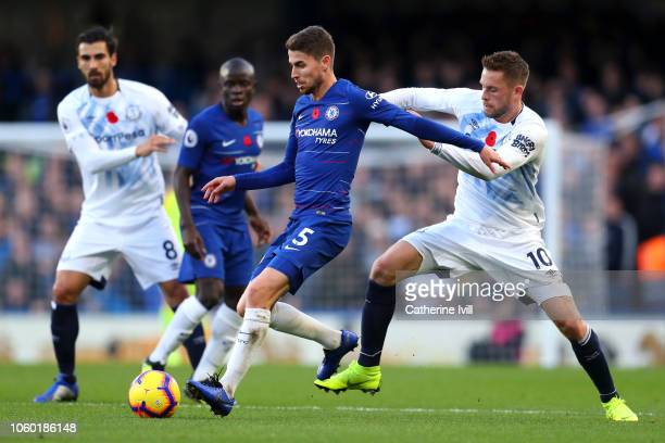 Jorginho of Chelsea battles for possession with Gylfi Sigurdsson of Everton during the Premier League match between Chelsea FC and Everton FC at...