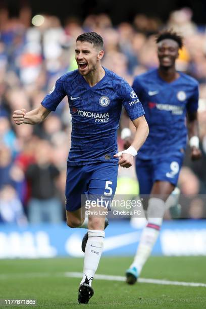 Jorginho of Chelsea celebrates after scoring his team's first goal during the Premier League match between Chelsea FC and Brighton & Hove Albion at...