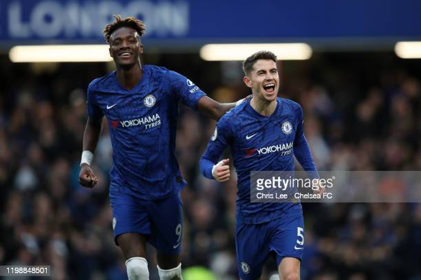 Jorginho of Chelsea celebrates after scoring his team's first goal with teammate Tammy Abraham during the Premier League match between Chelsea FC and...