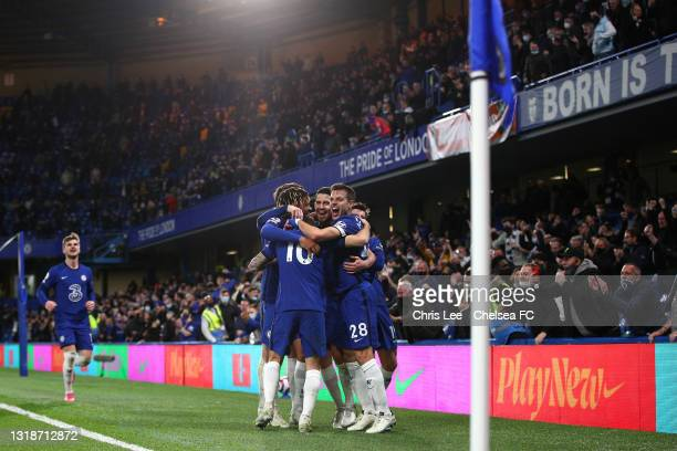 Jorginho of Chelsea celebrates after scoring their sides second goal from the penalty spot with team mates during the Premier League match between...