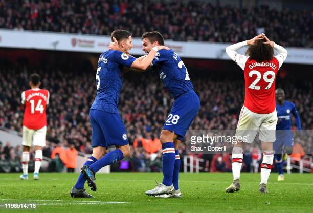 Jorginho of Chelsea celebrates with Cesar Azpilicueta of Chelsea after scoring his sides first goal during the Premier League match between Arsenal...