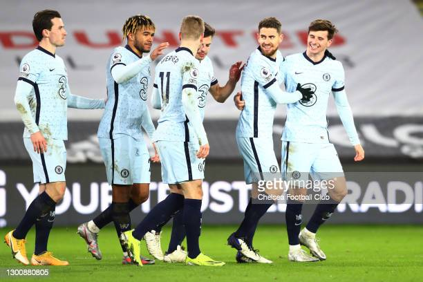 Jorginho of Chelsea celebrates with Mason Mount, Reece James and team mates after scoring their side's second goal from the penalty spot during the...