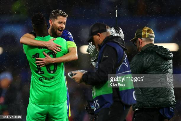 Jorginho of Chelsea celebrates with teammate Edouard Mendy at full-time after the UEFA Champions League group H match between Chelsea FC and Malmo FF...