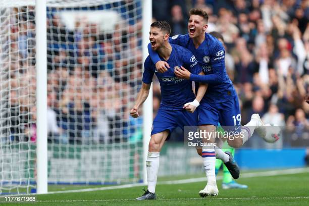 Jorginho of Chelsea celebrates with teammate Mason Mount after scoring his team's first goal during the Premier League match between Chelsea FC and...