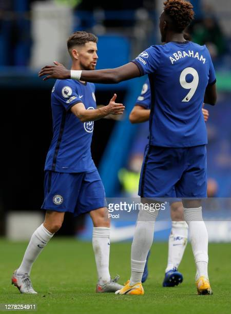 Jorginho of Chelsea celebrates with teammate Tammy Abraham after scoring his team's third goal during the Premier League match between Chelsea and...