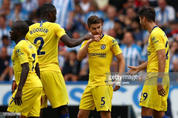 Jorginho of Chelsea celebrates with teammates after scoring his team's second goal during the Premier League match between Huddersfield Town and...