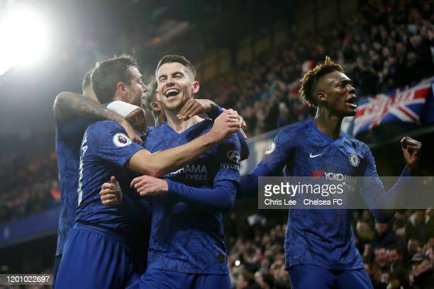 Jorginho of Chelsea celebrates with teammates after scoring his team's first goal during the Premier League match between Chelsea FC and Arsenal FC...