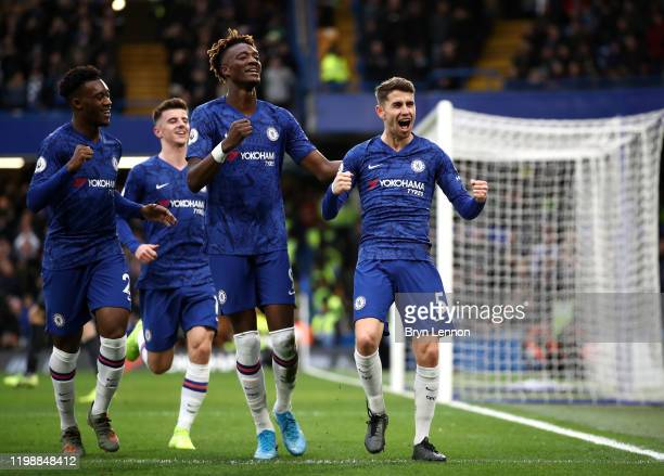 Jorginho of Chelsea celebrates with teammates Callum Hudson-Odoi and Tammy Abraham after scoring his team's first goal during the Premier League...
