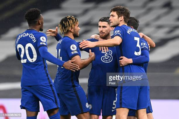 Jorginho of Chelsea celebrates with teammates Callum Hudson-Odoi, Reece James and Marcos Alonso after scoring his team's first goal during the...