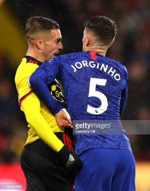 Jorginho of Chelsea clashes with Gerard Deulofeu of Watford during the Premier League match between Watford FC and Chelsea FC at Vicarage Road on...