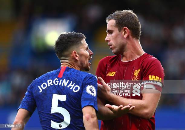 Jorginho of Chelsea confronts Jordan Henderson of Liverpool during the Premier League match between Chelsea FC and Liverpool FC at Stamford Bridge on...