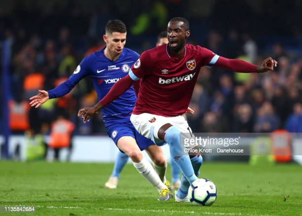 Jorginho of Chelsea FC and Pedro Obiang of West Ham United in action during the Premier League match between Chelsea FC and West Ham United at...